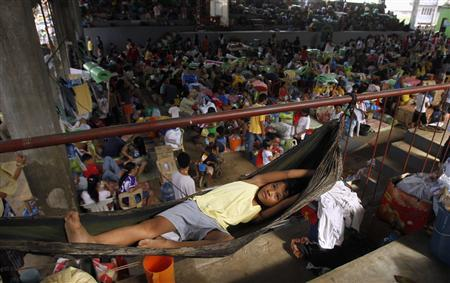 A girl rests in a hammock at an evacuation center for Typhoon Washi survivors in the southern Philippines city of Cagayan de Oro December 22, 2011.  REUTERS/Erik De Castro