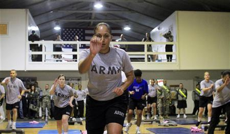 U.S. soldiers serving in the NATO peacekeeping mission in Kosovo take part in an exercise session with Billy Wayne Blanks, the inventor of Tae Bo exercise program, at the military camp Bondsteel in Sojevo, southeast of Kosovo's capital Pristina, January 17, 2011. REUTERS/Hazir Reka