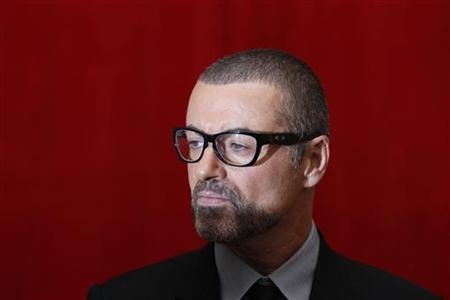 George Michael poses for photographers before a news conference at the Royal Opera House in central London, May 11, 2011.   REUTERS/Stefan Wermuth