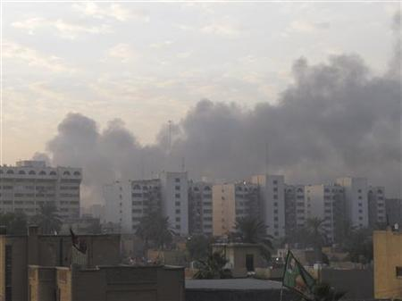 Smoke rises from the site of a bomb attack in central Baghdad December 22, 2011. REUTERS/Mohammed Ameen