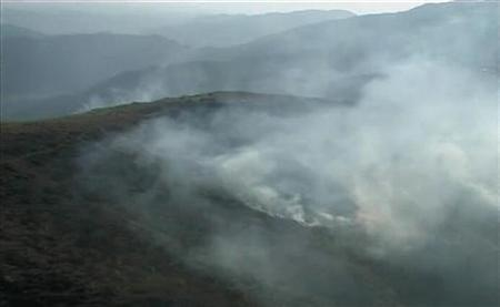 A still image taken from an ISPR (Inter Services Public Relations) video shows smoke billowing from a Pakistani army posts after a NATO attack in the Pakistan-Afghanistan border area November 30, 2011. REUTERS/ISPR via Reuters TV