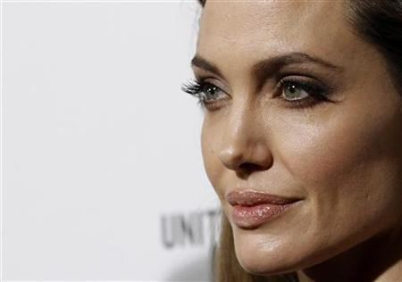 Director of the movie Angelina Jolie poses at the premiere of ''In the Land of Blood and Honey'' at the Arclight theatre in Los Angeles, California December 8, 2011. REUTERS/Mario Anzuoni