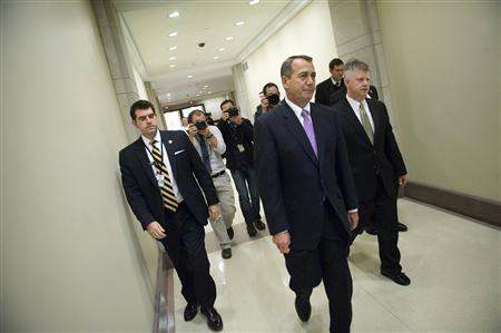House Speaker John Boehner (C) departs after announcing an agreement on the extension of the payroll tax holiday during a news conference at the U.S. Capitol in Washington December 22, 2011.   REUTERS/Jonathan Ernst