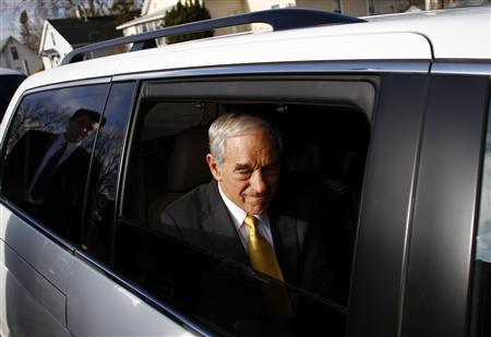 Ron Paul sits in his vehicle after speaking during a town hall meeting in Mount Pleasant, Iowa December 21, 2011. REUTERS/Joshua Lott