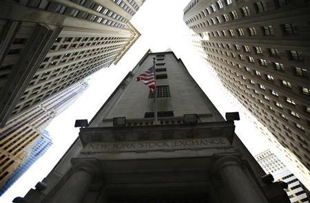 A U.S. flag flies outside the entrance to the New York Stock Exchange in New York, July 7, 2011. REUTERS/Brendan McDermid
