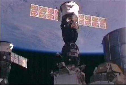 The Russian Soyuz TMA-03M spacecraft is seen docked to the International Space Station with European Space Agency astronaut Andre Kuipers, NASA astronaut Don Pettit and Russian cosmonaut Oleg Kononenko aboard awaiting hatch opening between the two spacecraft in this still image taken from NASA TV December 23, 2011.    REUTERS-NASA TV-Handout
