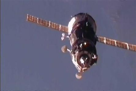 In this still image taken from NASA TV the Russian Soyuz TMA-03M spacecraft approaches the International Space Station for docking carrying European Space Agency astronaut Andre Kuipers, NASA astronaut Don Pettit and Russian cosmonaut Oleg Kononenko December 23, 2011.    REUTERS-NASA TV-Handout