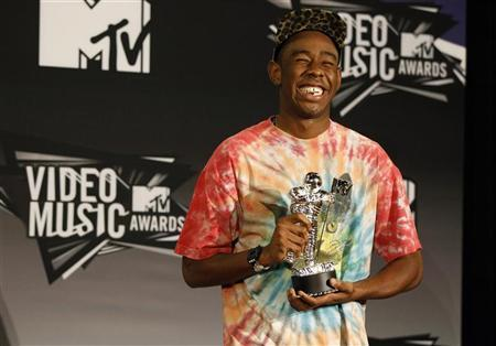 Tyler, The Creator holds his Best New Artist award which he won at the 2011 MTV Video Music Awards in Los Angeles August 28, 2011. REUTERS/Danny Moloshok