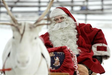 A man dressed like Santa Claus sits in his sleigh as he prepares for Christmas on the Arctic Circle in Rovaniemi, northern Finland, December 19, 2007. REUTERS/Kacper Pempel
