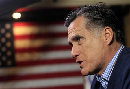 Republican presidential candidate and former Massachusetts Governor Mitt Romney is interviewed by Reuters on his campaign bus in Littleton, New Hampshire December 22, 2011.  REUTERS/Brian Snyder