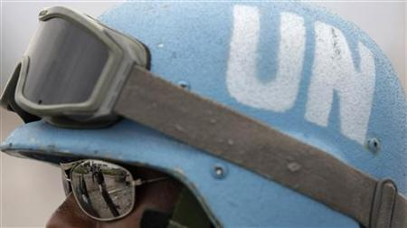 A UN peacekeeper from Brazil patrols a street in Port-au-prince January 19, 2010. REUTERS/Bruno Domingos