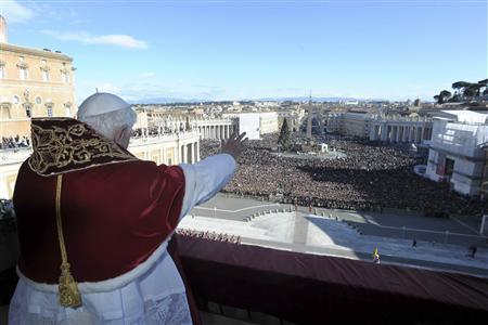 Pope Benedict XVI delivers the Urbi et Orbi (to the city and the world) Christmas Day message from the central balcony of Saint Peter's Square at the Vatican December 25, 2011. REUTERS/Osservatore Romano