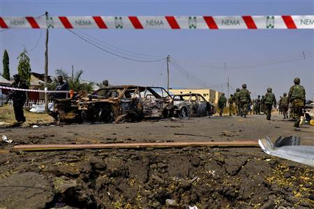 A security barrier marks the scene of a car bomb explosion at St. Theresa Catholic Church at Madalla, Suleja, just outside Nigeria's capital Abuja, December 25, 2011. REUTERS/Afolabi Sotunde