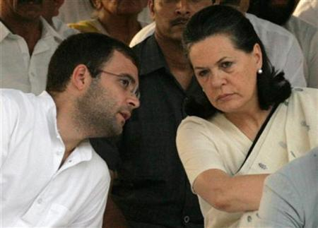 Chief of the Congress party Sonia Gandhi listens to her son Rahul Gandhi at the memorial of former prime minister Rajiv Gandhi on the occasion of the former prime minister's 18th death anniversary in New Delhi May 21, 2009. REUTERS/B Mathur/Files