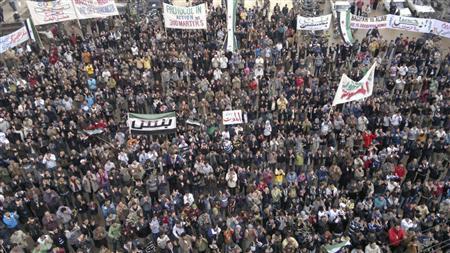 Demonstrators protest against Syria's President Bashar al-Assad after Friday prayers in Binsh near Adlb December 23, 2011. REUTERS/Handout