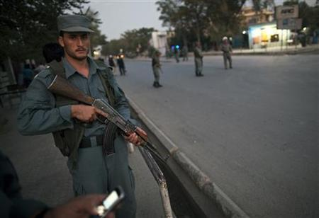 An Afghan policeman keeps watch near the house of the head of Afghanistan's High Peace Council Burhanuddin Rabbani, after a blast in Kabul September 20, 2011.  REUTERS/Ahmad Masood