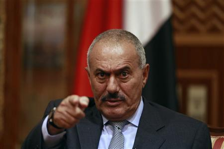 Yemen's President Ali Abdullah Saleh points during an interview with selected media, including Reuters, in Sanaa in this May 25, 2011 file photo. Saleh said on December 24, 2011 he would go to the United States in order to allow an interim government to prepare for an election to replace him, but did not specify when he would leave.   REUTERS/Khaled Abdullah/Files
