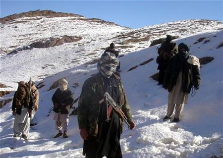 In this picture released exclusively to Reuters on January 31, 2009, Taliban militants with their weapons pose for pictures in an undisclosed location in Afghanistan January 30, 2009.REUTERS/Stringer/Files