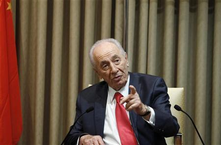 Israel's President Shimon Peres gestures during his meeting with General Chen Bingde, Chief of the General Staff of the Chinese People's Liberation Army (not seen), in Jerusalem August 16, 2011. REUTERS/Baz Ratner