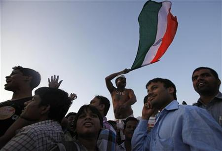 A supporter of veteran social activist Anna Hazare waves the national flag at the venue of his three-day fast at the Bandra-Kurla Complex (BKC) grounds Mumbai December 27, 2011. REUTERS/Danish Siddiqui