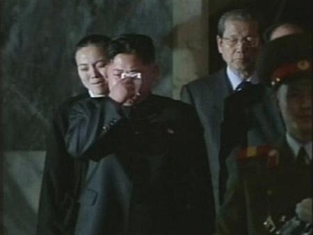 North Korea's new leader Kim Jong-un cries as his father, North Korea's late leader Kim Jong-il, lies in state during the run-up to his funeral in Pyongyang in this still image taken from video broadcast on December 27, 2011. REUTERS/KCNA via Reuters TV