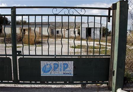 The locked entrance of the French company Poly Implant Prothese (PIP) building is seen in La Seyne-sur-Mer near Toulon, December 27, 2011.  REUTERS/Jean-Paul Pelissier