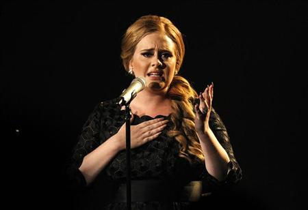 British singer Adele performs ''Someone Like You'' at the 2011 MTV Video Music Awards in Los Angeles, August 28, 2011. REUTERS/Mario Anzuoni