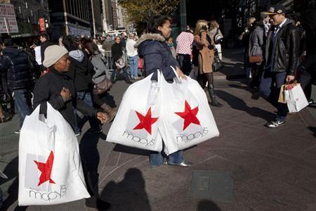 Black Friday shoppers cross 34th Street outside Macy's in Herald Square in New York November 25, 2011. REUTERS/Andrew Burton