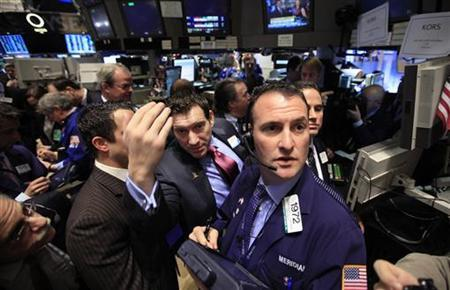 Traders await the start of the trading on the floor of the New York Stock Exchange December 15, 2011. REUTERS/Brendan McDermid