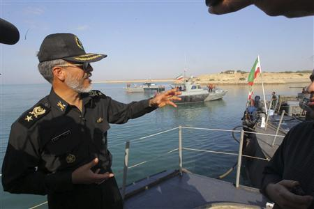 Iran's army's navy commander Habibollah Sayyari (L) gestures as he speaks with media during the Velayat-90 war game on Sea of Oman near the Strait of Hormuz in southern Iran December 28, 2011. ''Closing the Strait of Hormuz for Iran's armed forces is really easy ... or as Iranians say it will be easier than drinking a glass of water,'' Sayyari told Iran's English language Press TV. REUTERS/Fars News/Hamed Jafarnejad
