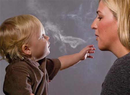 This handout image, released on November 10, 2010 depicts a mother blowing cigarette smoke in a child's face in one of the Federal Drug Administration's proposed new ''graphic health warnings.'' Diseased lungs, dead bodies, a man on a ventilator and mothers blowing smoke in their children's faces are among the images unveiled on Wednesday that U.S. health officials are considering in their effort to revamp tobacco warning labels. REUTERS/HHS/Handout