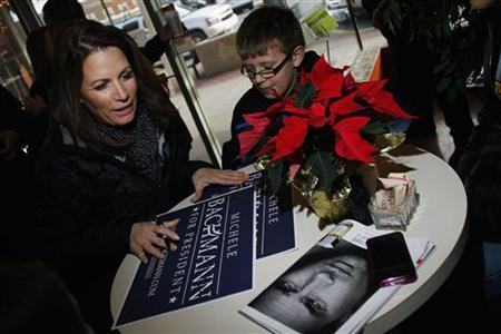 Republican presidential candidate and Representative Michele Bachmann (R-MN) signs an autograph at Uncle Nancy's Coffeeshop in Newton, Iowa December 23, 2011. REUTERS/Joshua Lott