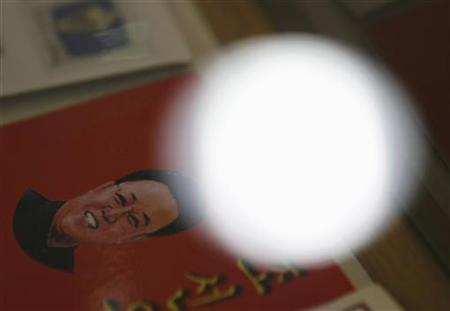 The late North Korean leader Kim Jong-il's image on a North Korean leaflet, is displayed at a museum of the Unification Observatory near the demilitarized zone (DMZ) which separates the two Koreas in Paju, north of Seoul, December 29, 2011. REUTERS/Kim Kyung-Hoon