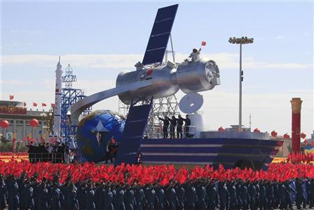 A float with a model featuring satellite is displayed during a  parade to mark the 60th anniversary of the founding of the People's Republic of China, in Beijing October 1, 2009.   REUTERS/David Gray