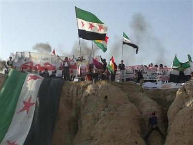 Demonstrators protest against Syria's President Bashar al-Assad in Amuda December 27, 2011. REUTERS/Handout