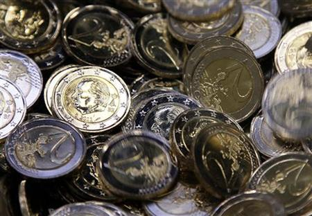 Two-euro coins are seen at Belgium's Royal Mint in Brussels December 8, 2011. REUTERS/Yves Herman/Files