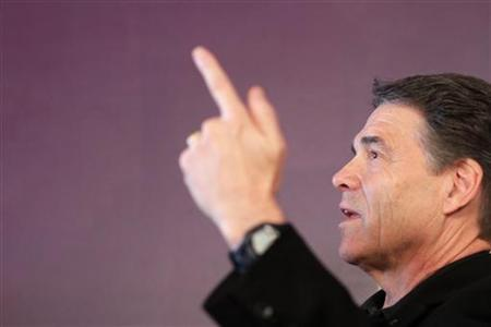 Republican presidential candidate Rick Perry campaigns at the Coffee Corner in Washington, Iowa December 29, 2011. REUTERS/John Gress