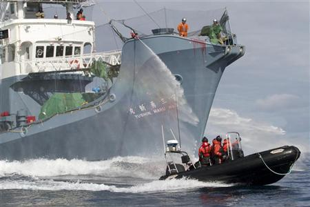 Japanese whaling fleet vessel Yushin Maru No. 3 sprays water cannons at Sea Shepherd activists in a dinghy boat during their clashes in the Southern Ocean February 4, 2011. REUTERS/Gary Stokes/Sea Shepherd/Handout