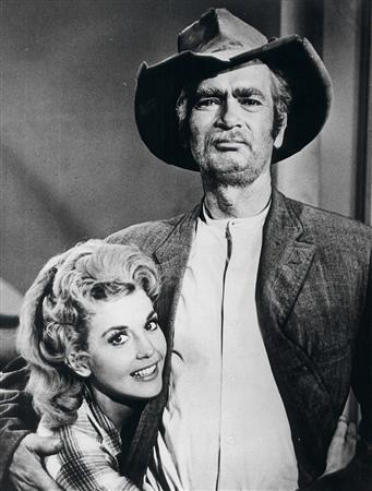 Stars of the popular 1960's ''The Beverly Hillbillies'' television series, Donna Douglas (L) who played Elly May Clampett and  Buddy Ebsen are shown in this undated publicity photograph from the series. Actress Donna Douglas, now 78,has settled her lawsuit against Mattel over a Barbie doll based on her character. Attorneys in the case filed court papers on December 27, 2011 in Louisiana indicating the lawsuit had been settled.  Douglas sued the toy company Mattel in May as well as the consumer products division of CBS Corp. seeking a minimum of $75,000 in damages.Her complaint said Mattel was ''engaging in the unauthorized use'' of her name, likeness and image to promote and sell the ''Elly May'' Barbie.   REUTERS/Handout