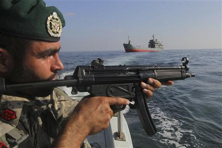 A military personnel participates in the Velayat-90 war game on Sea of Oman near the Strait of Hormuz in southern Iran December 28, 2011.  REUTERS/Fars News/Hamed Jafarnejad