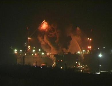 Firefighters work to extinguish fire at the Roslyakovo shipyard in the northern Russian region of Murmansk, in this still image taken from video, December 29, 2011.  REUTERS/TV21/Handout