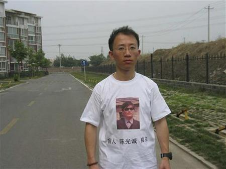One of China's most prominent dissidents, Hu Jia, wears a shirt in support of blind Chinese lawyer Chen Guangcheng, in this undated handout.   REUTERS/Handout