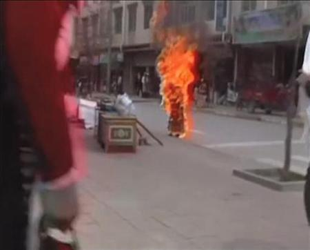 ATTENTION EDITORS - VISUAL COVERAGE OF SCENES OF INJURY OR DEATH Tibetan Buddhist nun Palden Choetso burns on the street in Daofu, or Tawu in Tibetan, in this still image taken from video shot on November 3, 2011 and released to Reuters on November 22. REUTERS/Students For A Free Tibet via Reuters TV/Files