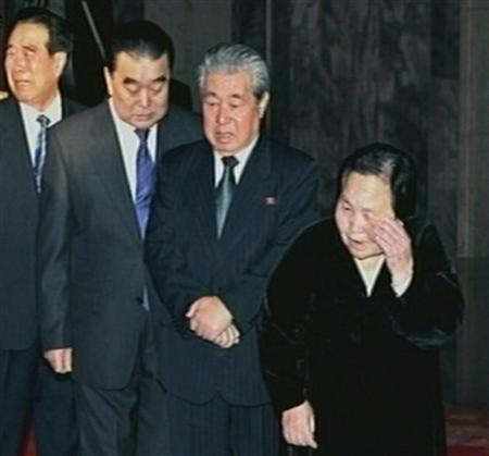 North Korea high level officials (L-R) Kim Phyong-hae, Thae Jong-su, Ju Kyu-chang and Kim Rak-hui mourn as they pay their last respects to former North Korean leader Kim Jong-il lying in state at the Kumsusan Memorial Palace in Pyongyang in this still picture taken from video footage of still images aired by KRT (Korean Central TV of the North) December 20, 2011. Little is known about elderly and silver-haired Ju, but he appears to be a key member of the North Korean team developing nuclear weapons. The European Union has named the 73-year-old, who is believed to have trained as a metal alloy specialist and studied in Russia, as one of the individual North Koreans to attract sanctions slapped on the rogue communist state.  REUTERS/KRT via REUTERS TV/Files