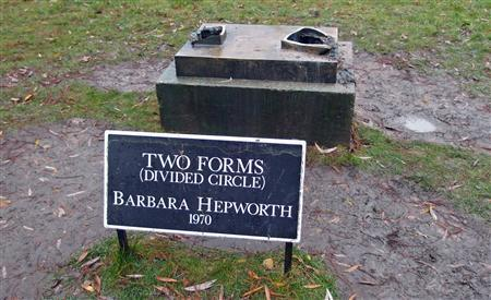 The plinth of the stolen Barbara Hepworth sculpture ''Two Forms (Divided Circle)'' is seen in Dulwich Park in southeast London, in this December 21, 2011 file photograph. Memorial plaques and artworks are unsentimentally lumped together with electrical cables and drain covers in the hunt for illegal metal, which police say costs Britain hundreds of millions of pounds each year and kills two thieves a month.  REUTERS/Laurel Wellman/files