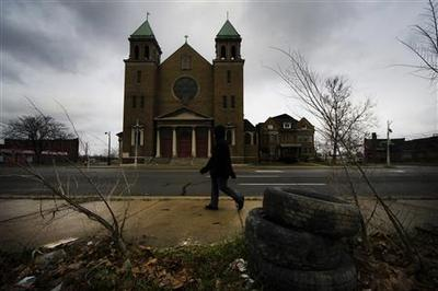 Insight: Dark holiday in Detroit as Church downsizes