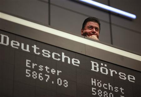 A bourse trader looks on during the last trading day at Frankfurt's stock exchange in Frankfurt December 30, 2011. REUTERS/Ralph Orlowski