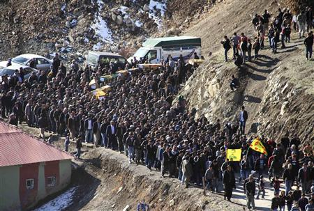 Coffins of victims killed in air strikes are carried by villagers during a funeral ceremony in Gulyazi near the southeastern Turkish town of Uludere, in Sirnak province, December 30, 2011.  REUTERS/Stringer