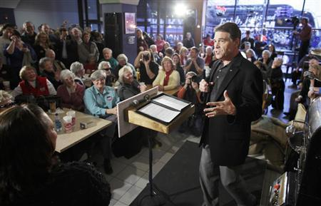 Republican presidential candidate Rick Perry campaigns at the Blue Strawberry Coffee Company in Cedar Rapids, Iowa December 29, 2011. REUTERS/John Gress