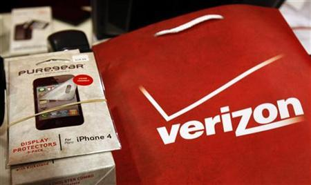 An iPhone 4 and accessories sit on a counter in a Verizon Wireless store shortly after the phone went on sale with Verizon service in New York, February 10, 2011. REUTERS/Mike Segar